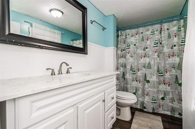 Bathroom featured at 703 W 8th St, Junction City, KS 66441
