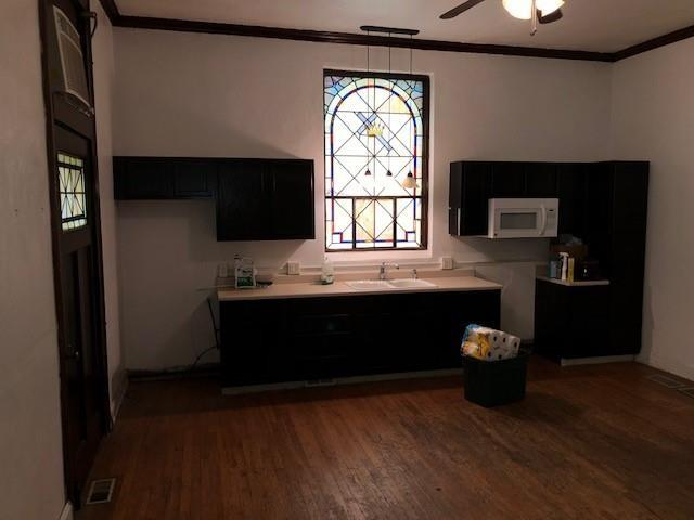 Kitchen featured at 301 S Main St, Nevada, MO 64772
