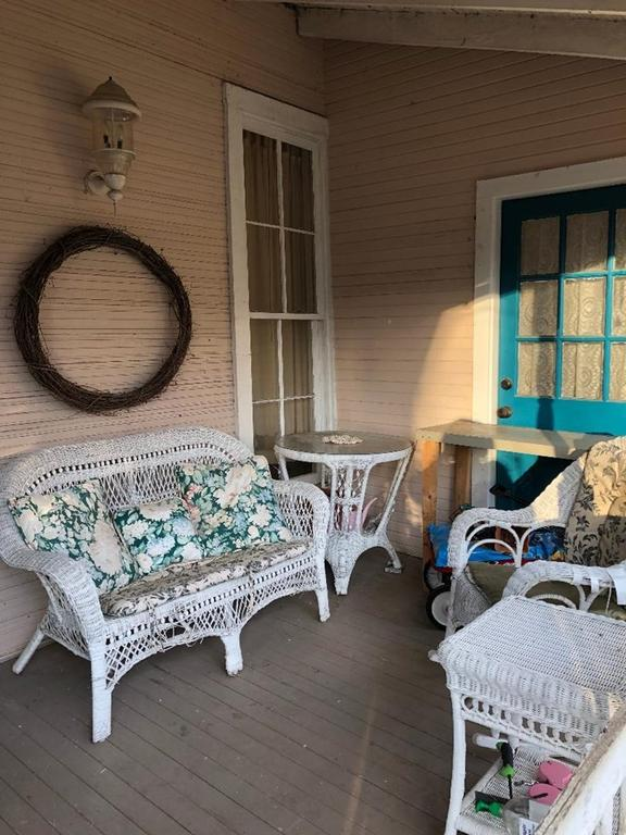 Porch featured at 93 E Pine St, Pachuta, MS 39347