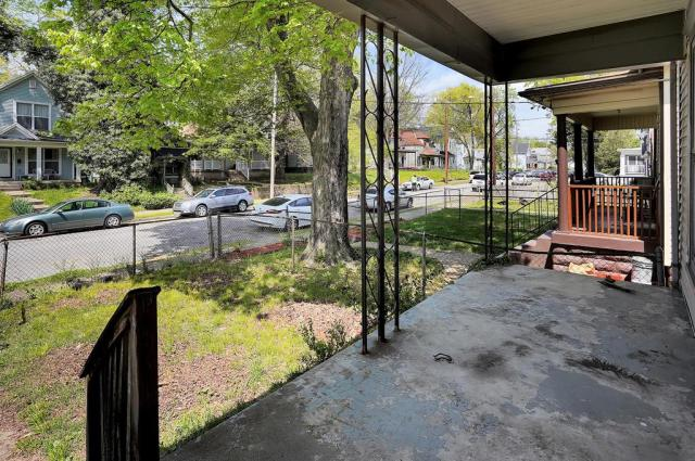 Porch yard featured at 1359 Olive St, Louisville, KY 40211