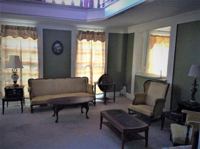 Living room featured at 106 Washington St N, Fort Gaines, GA 39851