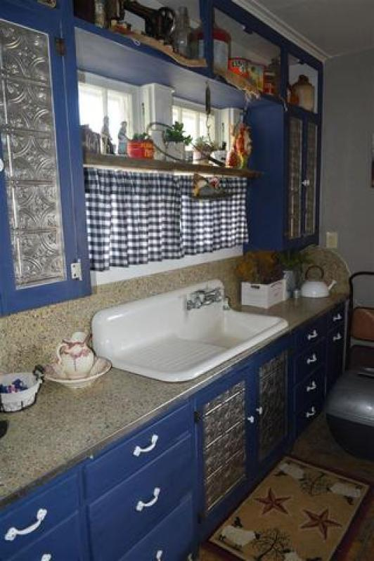 Bathroom featured at 228 E 1st St, Russell, KS 67665