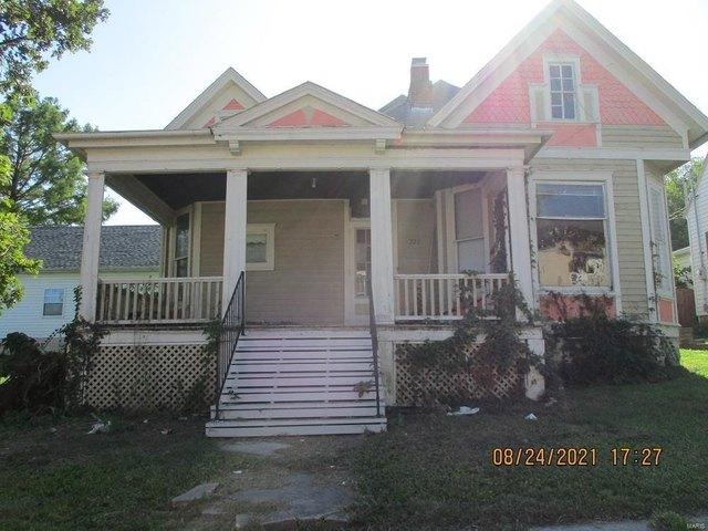 Porch featured at 220 N Main St, Louisiana, MO 63353