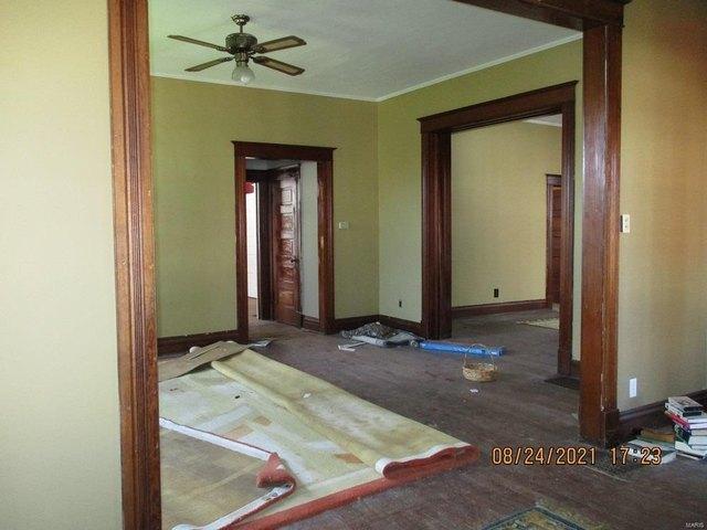 Bedroom featured at 220 N Main St, Louisiana, MO 63353