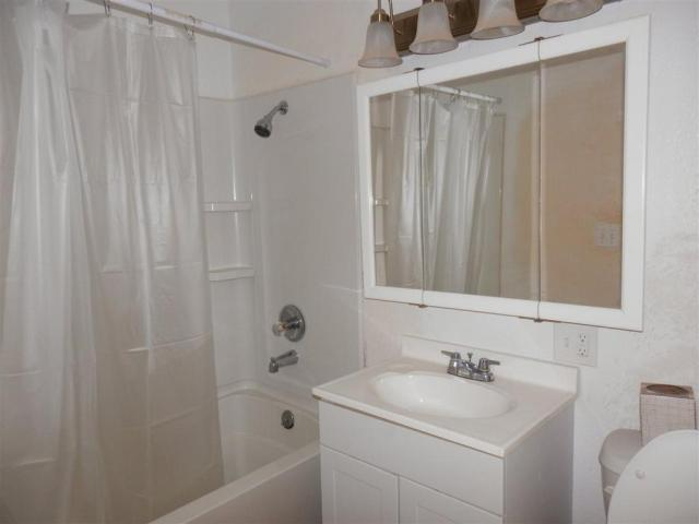 Bathroom featured at 721 E 2nd St, Russell, KS 67665