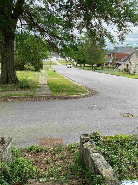 Road view featured at 701 Green Ave NW, Russellville, AL 35653