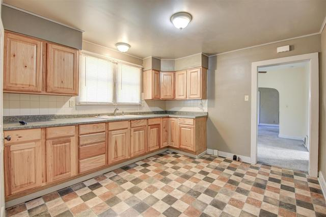 Kitchen featured at 435 3rd Ave N, Clinton, IA 52732