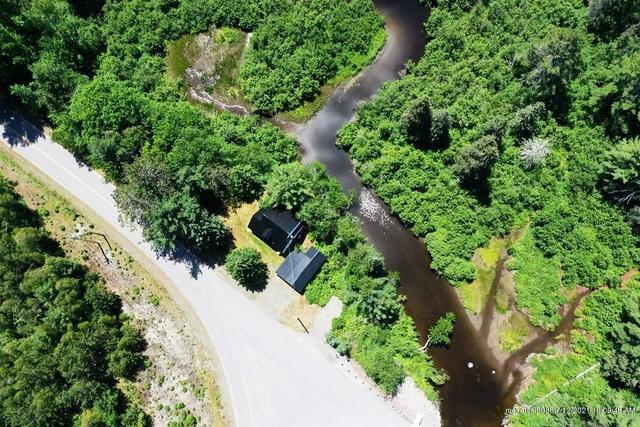 Road view featured at 19 Herring Tract Rd, Willimantic, ME 04443
