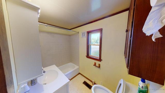 Bathroom featured at 19 Herring Tract Rd, Willimantic, ME 04443