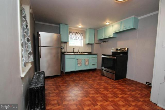 Kitchen featured at 165 N Hanover St, Pottstown, PA 19464