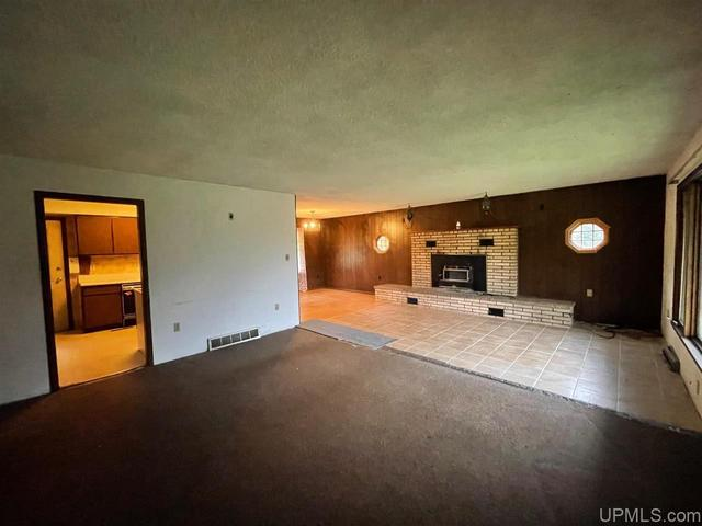 Living room featured at N9590 Petes Dr, Felch, MI 49831
