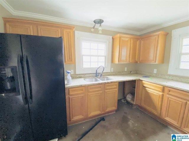 Kitchen featured at 801 Parker St, Anniston, AL 36201