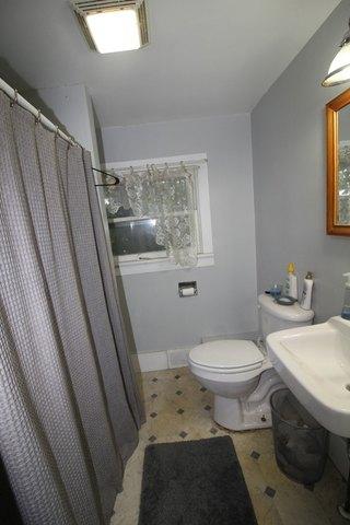 Bathroom featured at 232 Clay St, Savanna, IL 61074