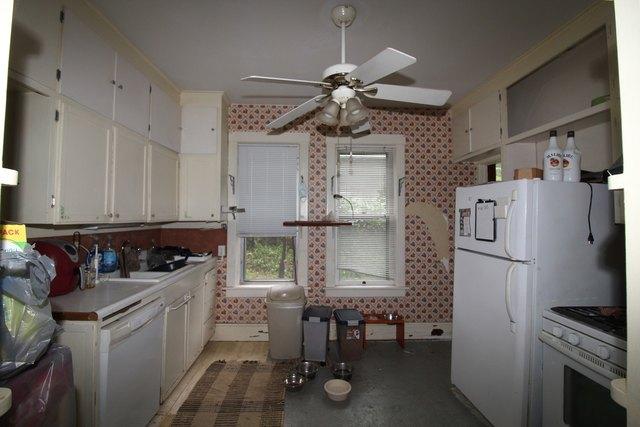 Kitchen featured at 232 Clay St, Savanna, IL 61074