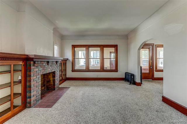 Living room featured at 52 Elm St, River Rouge, MI 48218