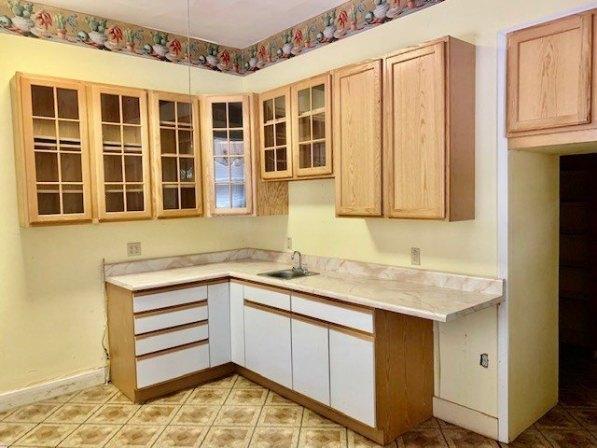 Kitchen featured at 412 W 9th St, Coffeyville, KS 67337