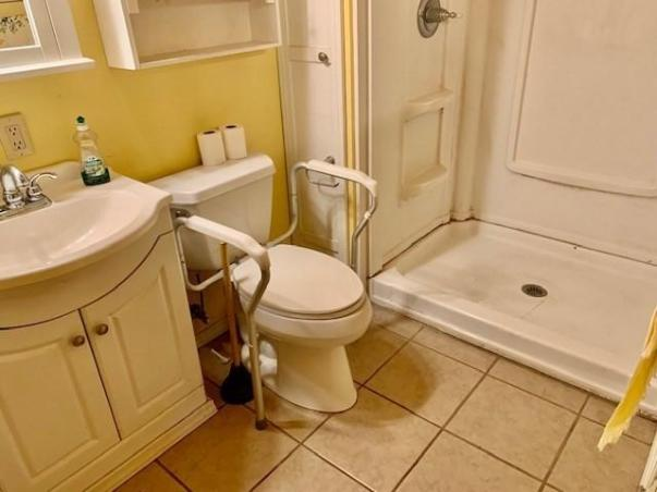 Bathroom featured at 412 W 9th St, Coffeyville, KS 67337