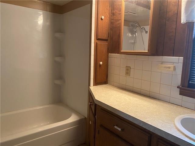 Bathroom featured at 403 W Pine St, Oregon, MO 64473
