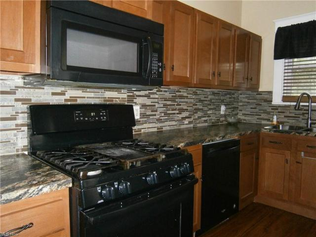 Kitchen featured at 126 S Pearl St, Youngstown, OH 44506