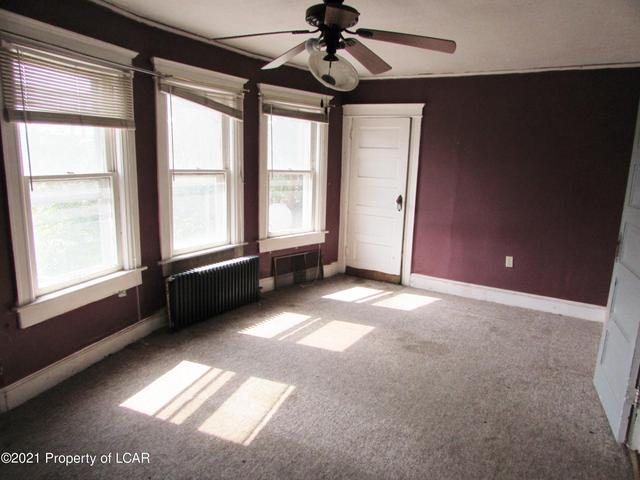 Bedroom featured at 329 E Main St, Plymouth, PA 18651
