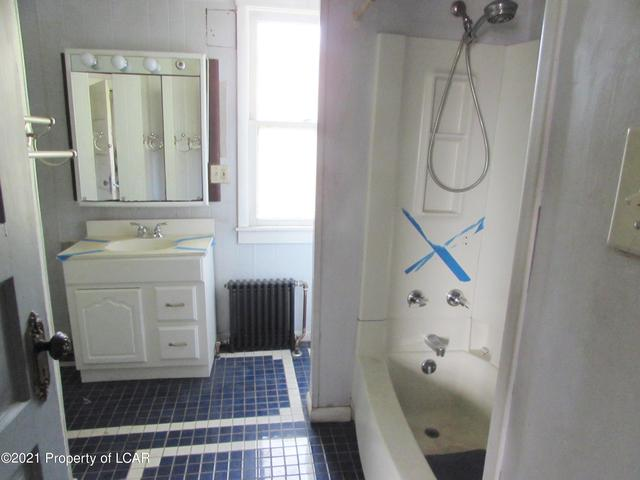 Bathroom featured at 329 E Main St, Plymouth, PA 18651