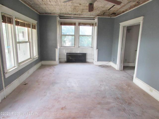 Living room featured at 329 E Main St, Plymouth, PA 18651