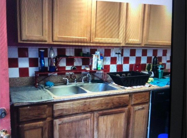 Kitchen featured at 201 2nd St NE, Live Oak, FL 32064