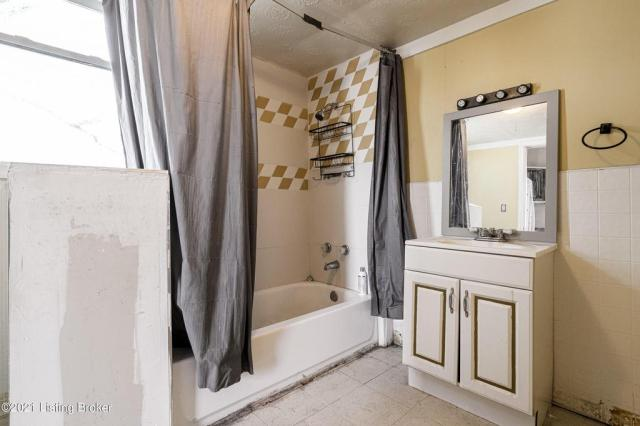Bathroom featured at 3119 Portland Ave, Louisville, KY 40212