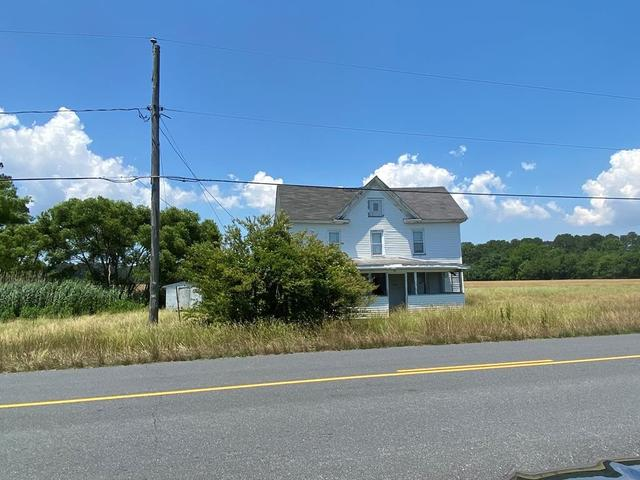 Road view featured at 35128 Seaside Rd, Painter, VA 23420