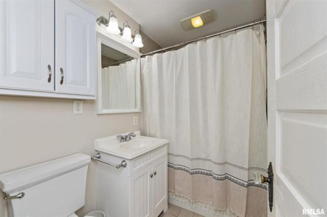 Bathroom featured at 1219 N Garfield Ave, Peoria, IL 61606