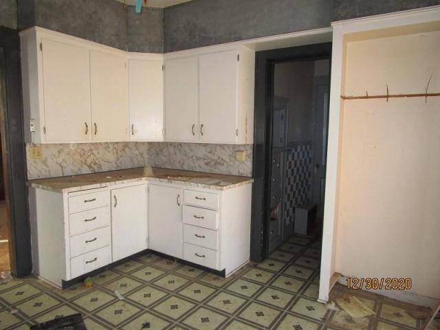 Kitchen featured at 804 S Grand Ave, Lyons, KS 67554