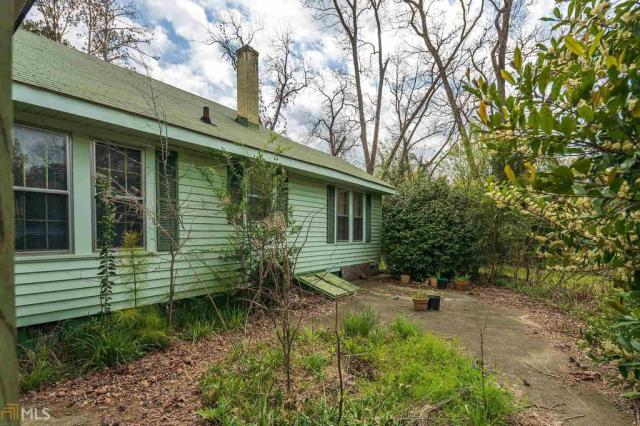 House view featured at 211 W Adams St, Tennille, GA 31089