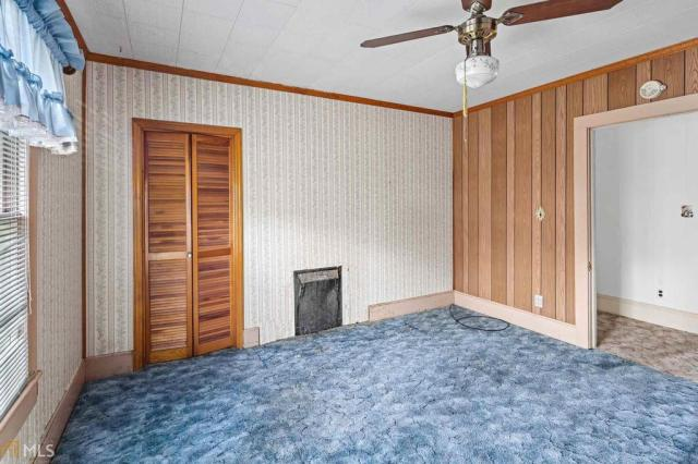 Bedroom featured at 211 W Adams St, Tennille, GA 31089
