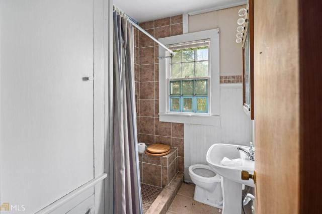 Bathroom featured at 211 W Adams St, Tennille, GA 31089