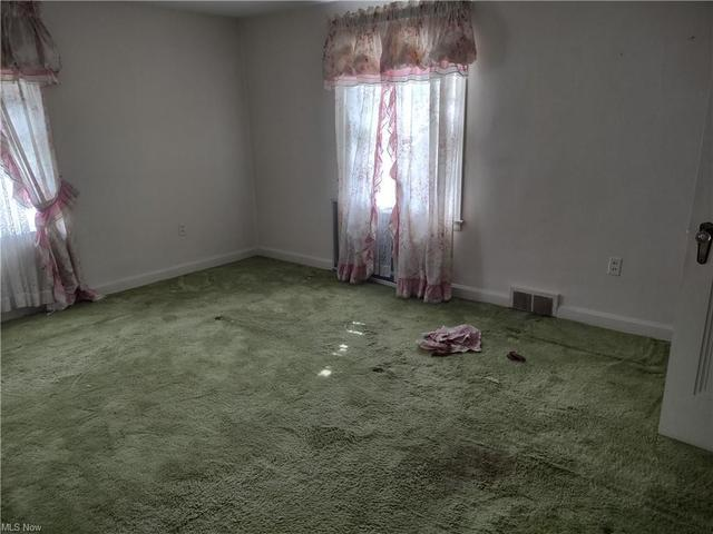 Bedroom featured at 27 W 4th St, Newton Falls, OH 44444