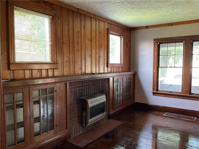 Living room featured at 111 Main St, New Haven, WV 25265