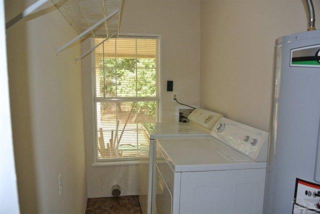 Laundry room featured at 5714 Sunbeam St, Milton, FL 32570