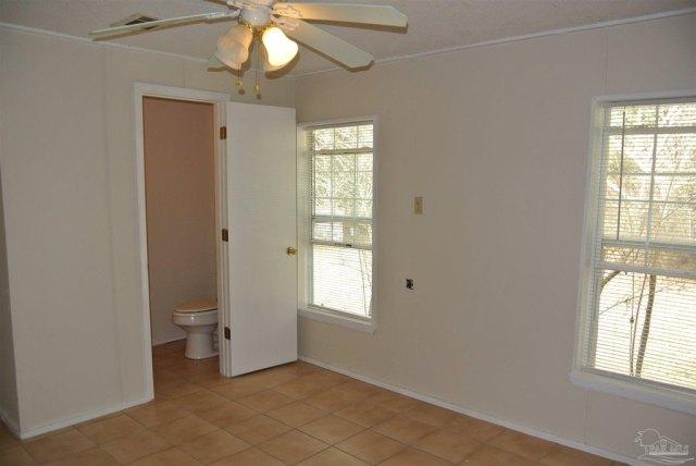 Bedroom featured at 5714 Sunbeam St, Milton, FL 32570