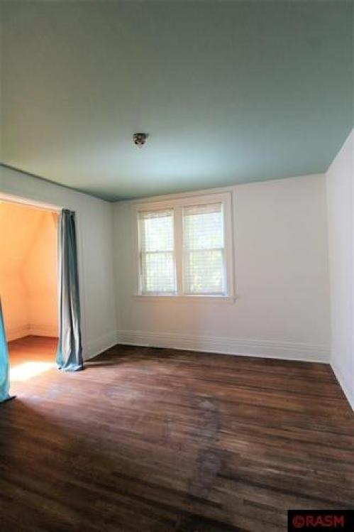 Bedroom featured at 418 S Broadway St, New Ulm, MN 56073