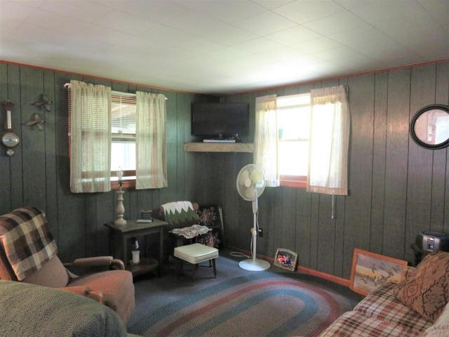 Living room featured at 945 Margaret Lake Rd, Three Lakes, WI 54562
