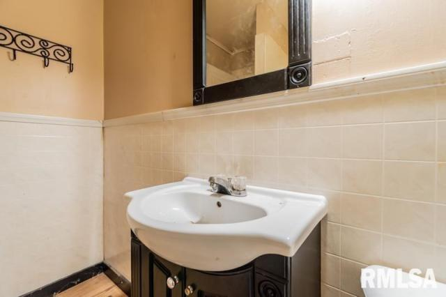 Bathroom featured at 1197 Clark St, Lowpoint, IL 61545