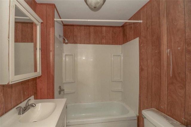 Bathroom featured at 606 W School St, Crocker, MO 65452