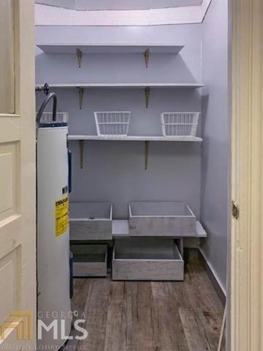 Laundry room featured at 608 Ware St, Waycross, GA 31503