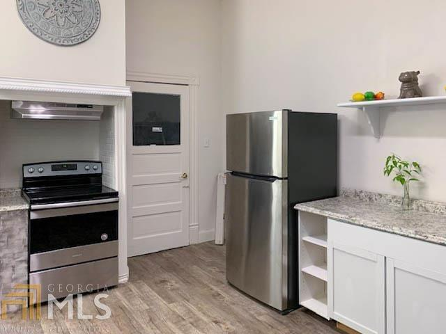 Kitchen featured at 608 Ware St, Waycross, GA 31503