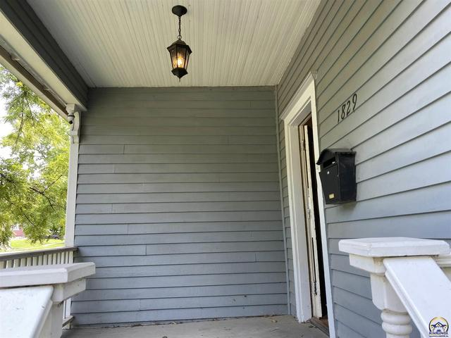 Porch featured at 1829 SW 2nd St, Topeka, KS 66606