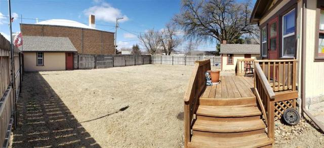Porch yard featured at 321 E 1st St, Bison, KS 67520