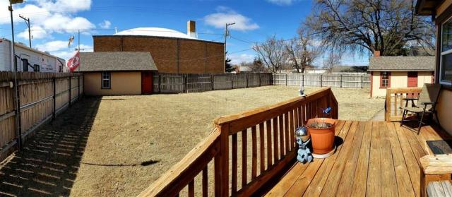 Porch featured at 321 E 1st St, Bison, KS 67520