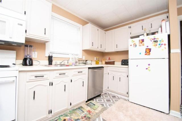 Kitchen featured at 127 Tinker Blvd, Warner Robins, GA 31093