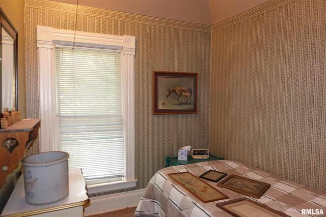 Bedroom featured at 624 N Cherry St, Galesburg, IL 61401
