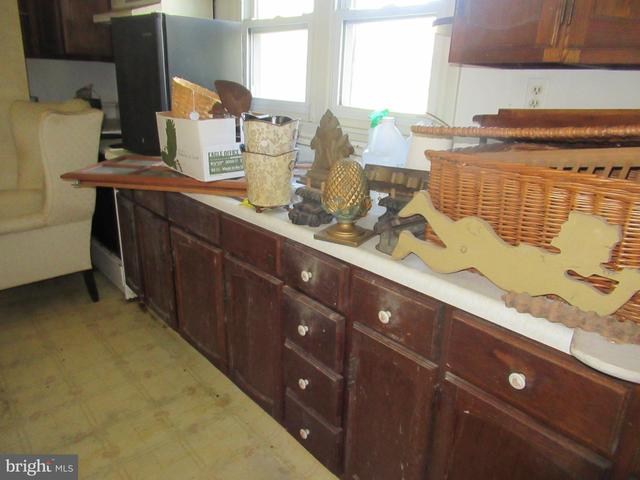 Kitchen featured at 26692 Old State Rd, Crisfield, MD 21817